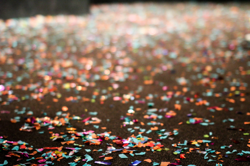confetti on floor after celebration