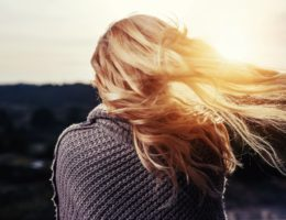 blonde woman hair blowing in wind falling in love
