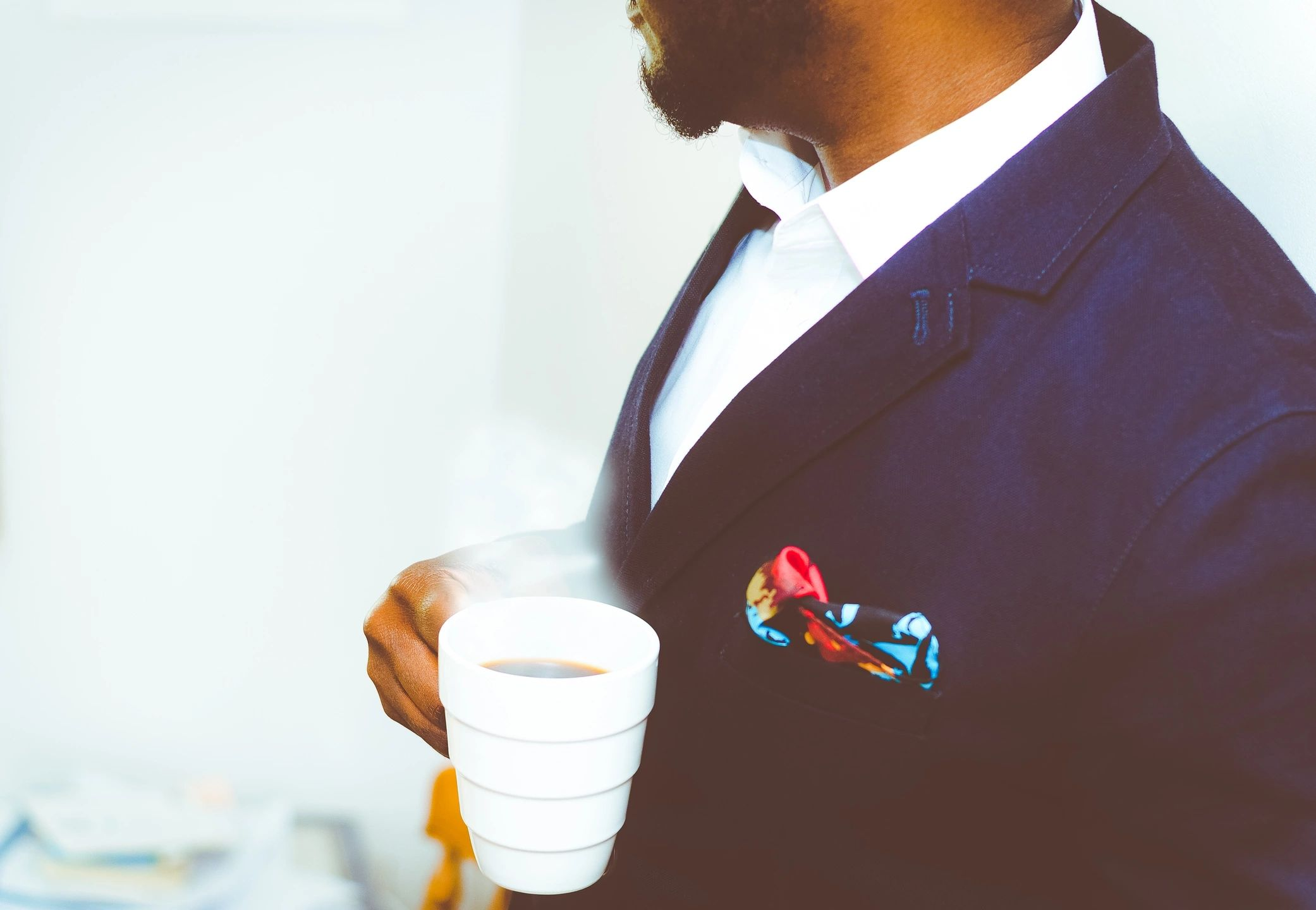 man holding coffee going to work
